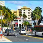 Scene of tourists walking around Condado and the metro bus.