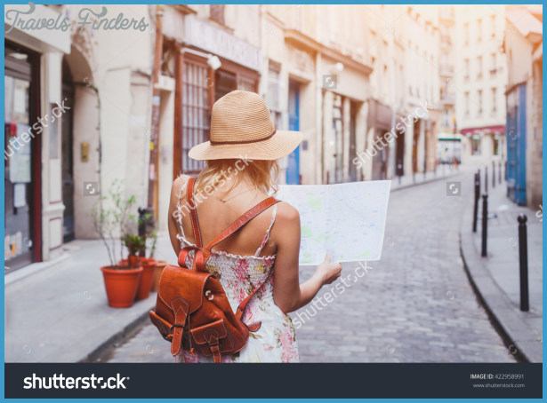 stock-photo-travel-guide-tourism-in-europe-woman-tourist-with-map-on-the-street-422958991.jpg