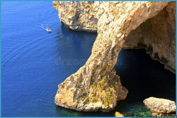 blue-grotto-southeastern-coast-malta-famous-its-eerie-azure-waters-popular-spot-tourist-boat-32390207.jpg