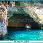 tourist-boat-in-the-blue-grotto-sea-caves-in-malta-ea05jm.jpg